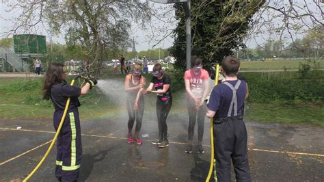 Pretty Muddy competitors hosed down by Fire Cadets